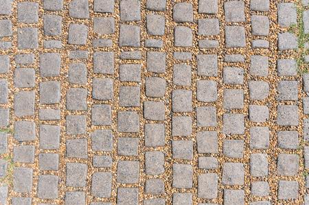 Schließen Sie herauf Steinpflastertextur zur Verwendung als abstrakter Hintergrund Standard-Bild
