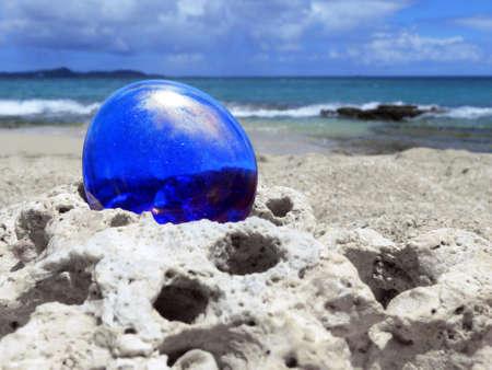 Blue Shiny Stone on Seascape Background  Stock Photo