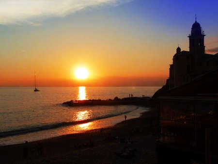 valentine s day beach: Quiet ending summer sunset on camogli s bay