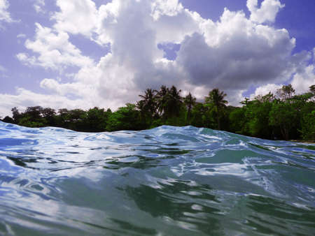 Tropical island view from sea Stock Photo