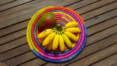 Mango with bananas on the wooden table Stock Photo