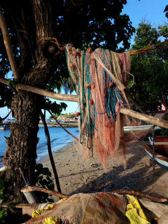 Fishing net to dry on the beach Stock Photo - 92858811
