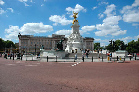 Buckingham palace and surrounding gardens in a sunny day photo