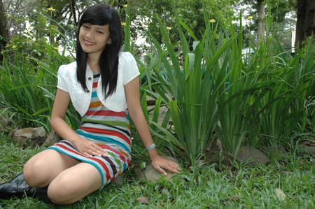 young lady sit down in park 免版税图像