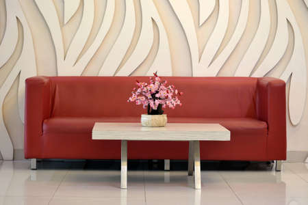 red sofa: flower vase and red sofa