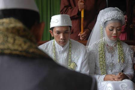 cikijing, west java, indonesia - july 10, 2011  bride and groom wearing traditional west java wedding costume