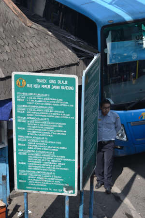 bus station: bandung, indonesia-june 16, 2014  bus parking at cicaheum bus station waiting for passenger to board