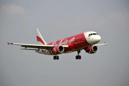 manoeuvre: bandung, indonesia-june 16, 2014  Air Asia airplane taking manoeuvre on husein sastranegara airport bandung