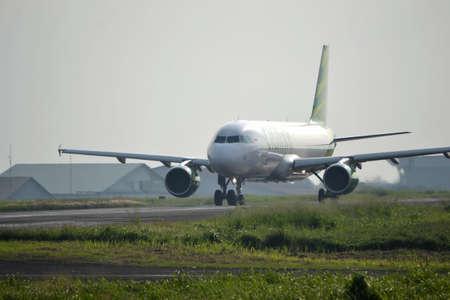 manoeuvre: bandung, indonesia-june 16, 2014  Citilink airplane taking manoeuvre on husein sastranegara airport bandung  Editorial