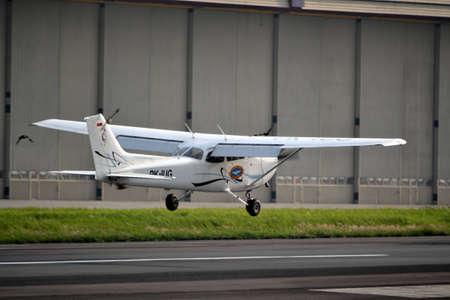 manoeuvre: bandung, indonesia-june 16, 2014  Cesna airplane taking manoeuvre on husein sastranegara airport bandung  Editorial