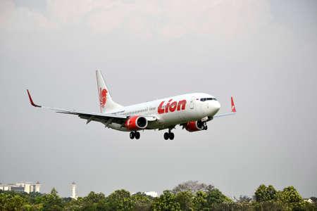 manoeuvre: bandung, indonesia-june 16, 2014  Lion Air airplane taking manoeuvre on husein sastranegara airport bandung