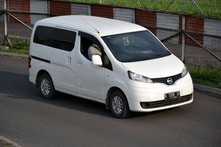 bandung, indonesia-june 16, 2014  white colored nissan evalia cruising on the road