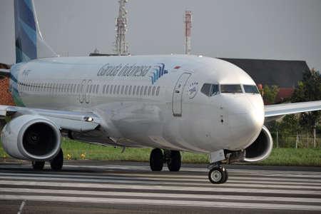bandung, indonesia-june 16, 2014  Garuda Indonesia airline taking manoeuvre on husein sastranegara airport bandung