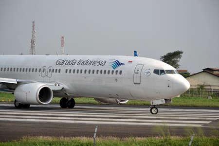 manoeuvre: bandung, indonesia-june 16, 2014  Garuda Indonesia airline taking manoeuvre on husein sastranegara airport bandung