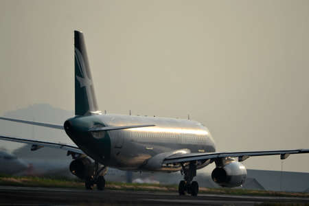 manoeuvre: bandung, indonesia-june 16, 2014  Silk Air airplane taking manoeuvre on husein sastranegara airport bandung