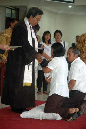 bandung, indonesia-december 19, 2010  Baptism - a christian rite of admission and almost invariably with the use of water, into the christian church generally and also a particular church tradition