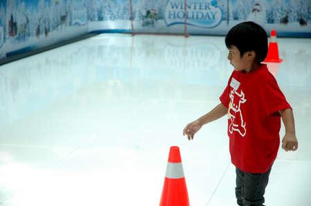 bandung, indonesia-december 17, 2011  boy learning inline skate at bandung supermall venue