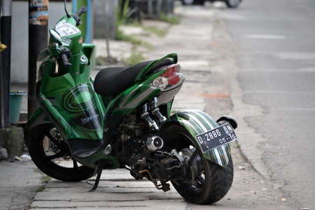bandung, indonesia-july 29, 2014  yamaha mio soul gt motorcycle with modification style get parked beside road