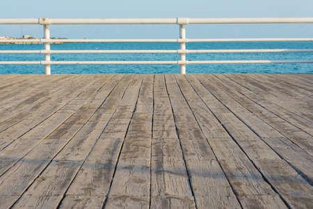 Wooden Boardwalk Next To The Beach.