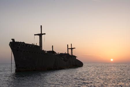 greek island: The Greek Ship Wreckage in Kish Island at Sunset