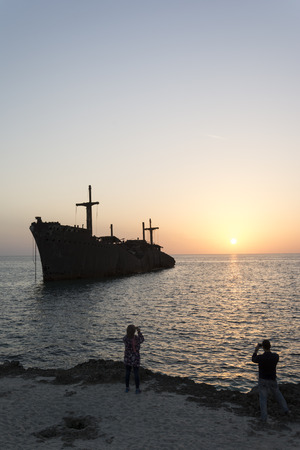wreckage: Taking Photos By Cell phones From Greek Ship Wreckage in Kish Island at Sunset Stock Photo
