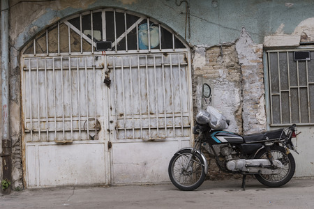 diffused: Downtown Area, Ancient Building Architecture and A Motorcycle in Urban Area , Tehran