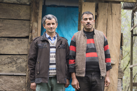 herder: Gilan, IRAN - March 22, 2016: Portrait of Two Taleshi Herder in Front of a Chalet. Gilan Province Editorial