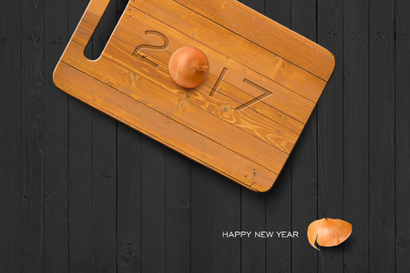 antiseptic: 2017 Happy New Year Concept, 2017 Text on Wooden Antiseptic Cutting Board With Onion on Grey Wall Texture. Selection Path Included.3D illustration, 3D rendering Stock Photo