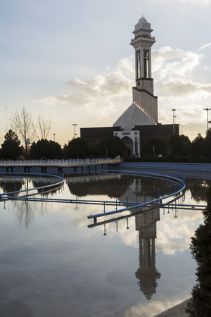 Tehran International Permanent Fairground, Reflection of  Minaret  in Waters Pool, Vertical Shot.