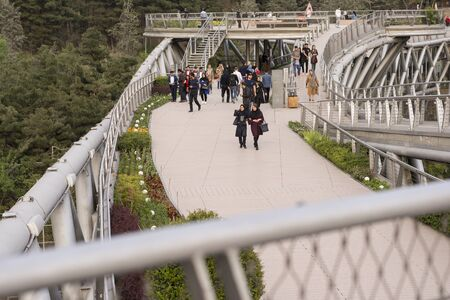 Tehran, IRAN - April 9, 2018 Tabiat bridge, people walking in modern architectural structure. Редакционное
