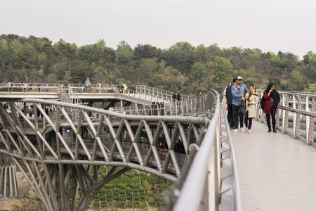 Tehran, IRAN - April 9, 2018 Tabiat bridge, people walking in modern architectural structure in tehran.