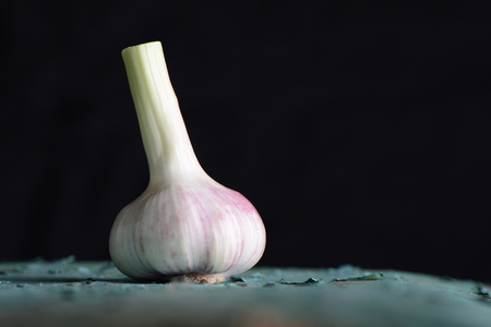 Fresh garlic in front of dark background, healthy eating or lifestyle nutrition concept