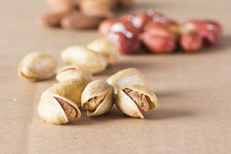Group of dry nuts- pistachio and almonds, healthy nutrition background Фото со стока