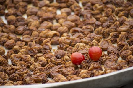 Homemade dried ripen plums in metal tray is widely used in cooking
