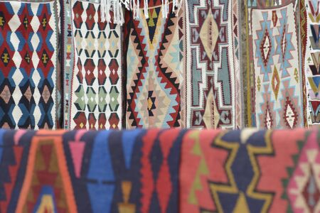 Multiple colorful oriental Iranian rug or kilim with traditional folk geometric patterns