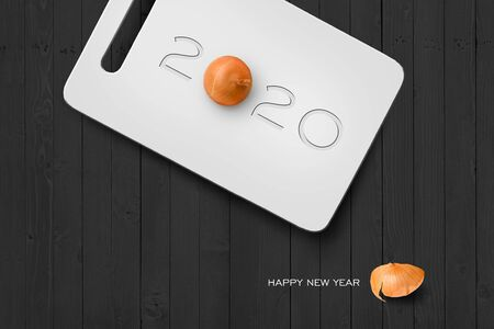 2017 Happy New Year Concept, 2020 Text on Plastic Antiseptic Cutting Board With Onion on Grey Wall Texture. Selection Path Included.