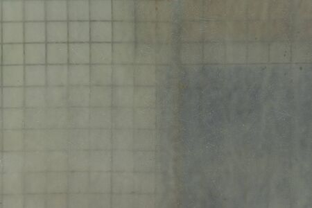 Matt transparent plate in front of metal bars squares, abstract textures Imagens