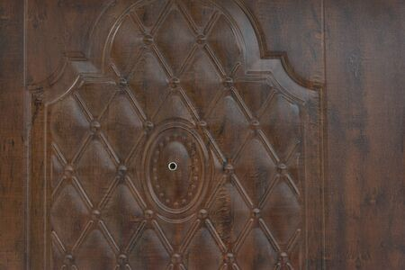 Wooden door texture with security eye piece at center