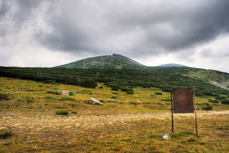 Old rusty sign in the middle of Rila mountains photo