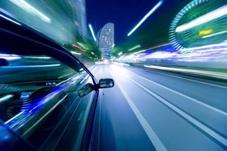 The car moves at great speed at the night. photo