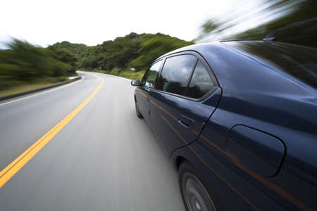 The car moves at great speed at the mountain road Stock Photo - 6993670