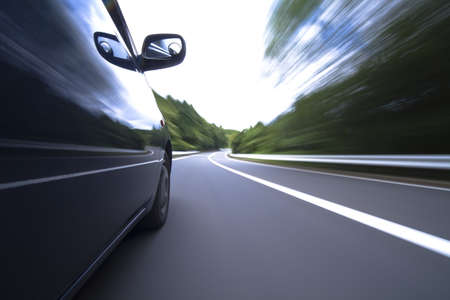 The car moves at great speed at the mountain road photo