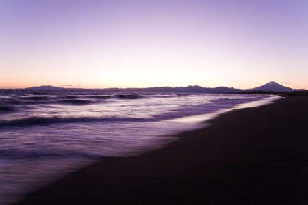 Sunset scene on the sea and Mt fuji in Japan. photo