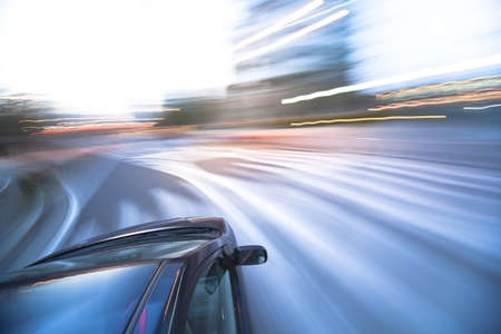 The car moves at great speed at the evening Stock Photo - 6993791
