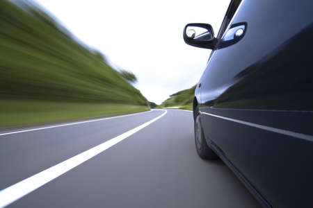 The car moves at great speed at the mountain road Stock Photo - 6993778