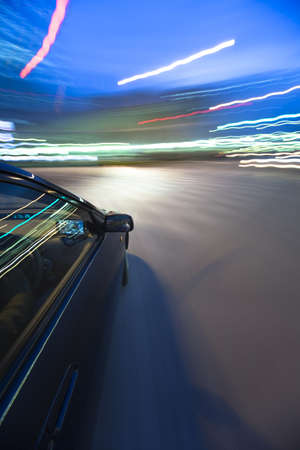 The car moves at great speed at the night photo