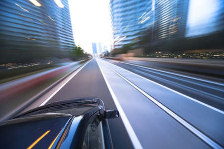 The car moves at great speed at the evening Stock Photo - 7059629
