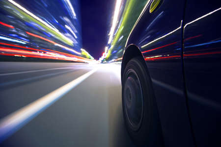 fast lane: The car moves at great speed at the night.