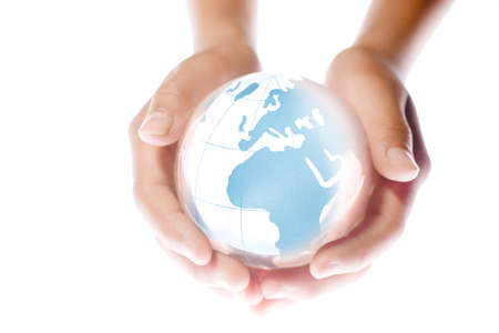 Child holding a globe in hands. Stock Photo - 7059484