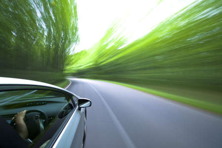 car side: car driving fast into forest